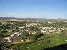 Panorama of Prineville city, Crook County, and the Ochoco Mountains.