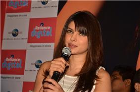 Priyanka Chopra talking to a microphone, in 2012