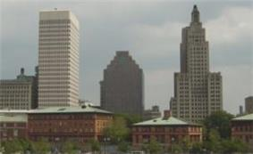 Three buildings, two of the same stature, and one smaller than the others