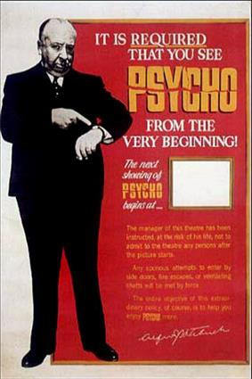 A large image of Hitchcock pointing at his watch. The words at the other side of the poster say