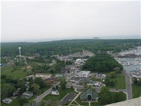View from atop the observation deck of the Perry Memorial, looking down into the village's downtown area and DeRiveria Park (wooded area to the right)