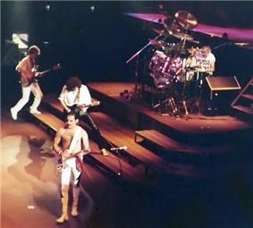 Left to right: John Deacon (side), Freddie Mercury (front), Brian May (rear) and Roger Taylor (back)