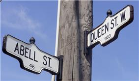 Street signs for Queen Street West and Abell Street, in West Queen West.