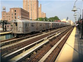 A train made of R32 cars in J service at Marcy Avenue, bound for Queens.