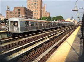 A train made of R42 cars in J service at Marcy Avenue, bound for Queens.