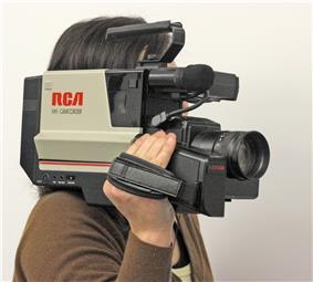 Large shoulder-mount camcorder, hiding operator's face