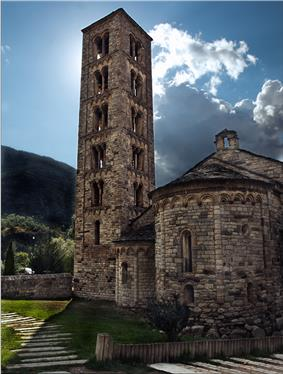 Stone church with a separate massive tower.