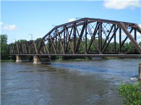 A typical steel truss railway bridge.
