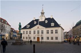 The old Town Hall on the square in Randers with a statue of Niels Ebbesen in front.