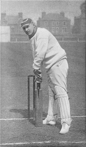 a cricketer standing in front of some stumps, preparing to hit the ball