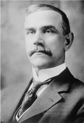 Upper-body portrait of a early-twentieth-century man in a suit.