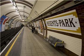 An underground railway platform with the words
