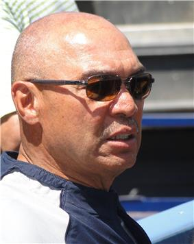 A side-view of Reggie Jackson wearing sunglasses.