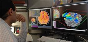 Researcher checking fMRI images