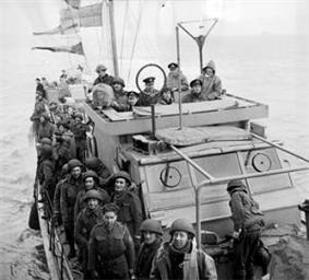 Soldiers crowded on the deck of a Motor Torpedo Boat