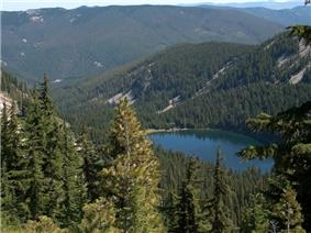 Revett Lake and surrounding mountains and forests from above.