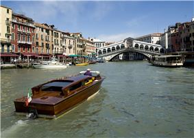 Venice in spring, with the Rialto Bridge in the background.