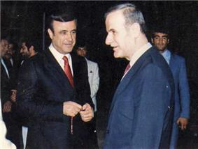 Two men in suits, standing