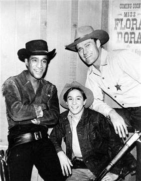Sammy Davis, Jr., Johnny Crawford, and Chuck Connors in Western costume.