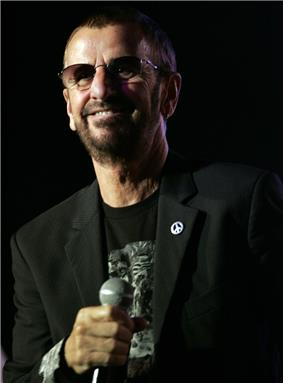 A colour photograph of Starr wearing sunglasses and a black T-shirt.