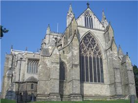 The square east end of Ripon Cathedral is defined by strongly projecting buttresses terminating in gables and pinnacles. There is a large decorated east window with tracery in a circle like the west window at Exeter.