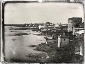 An old photograph showing buildings lining the river banks of the Rio de la Plata at Buenos Aires.