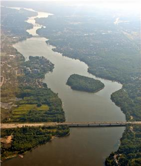 Aerial view of Rivière des Prairies with Louis Bisson Bridge in the foreground. The island