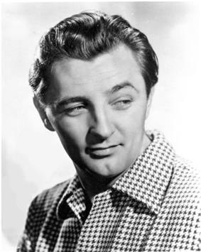 Black and white promotional headshot of Robert Mitchum facing right and looking left