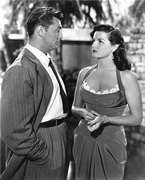 Black and white promotional image of Jane Russell (right) and Robert Mitchum in the 1951 movie His Kind of Woman