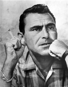 Dark-haired man smoking a cigarette.
