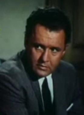 Screenshot of Rod Steiger in the trailer for the film, The Unholy Wife in 1957.