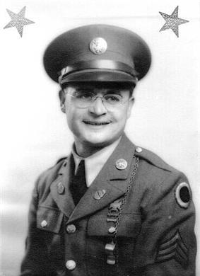 Head and shoulders of a smiling young white man wearing a peaked cap, wire-framed glasses, and, over a shirt and tie, a jacket adorned with pins on the lapels, stripes and a round badge on the shoulder, and a whistle on a chain hanging from a shoulder button.