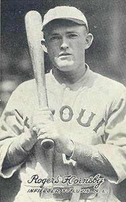Rogers Hornsby in a St. Louis Browns uniform, a bat held over his right shoulder