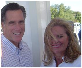 Casual photograph of Mitt and Ann Romney outdoors with wind blowing her hair