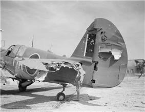 Damaged tail assembly of a single-engined fighter plane