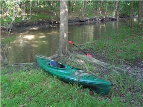 Photo of single-person kayak sitting on land