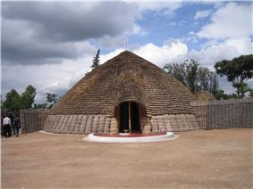 Photograph of King's palace in Nyanza, Rwanda depicting main entrance, front and conical roof