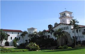 Photograph of the gardens and Spanish colonial façade of the Santa Barbara County Courthouse