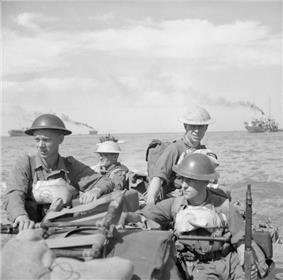 British troops in a landing craft make their way ashore on Ramree Island, 21 January 1945.