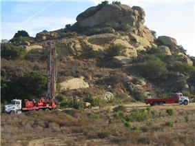Drilling and flatbed trucks and an all-terrain vehicle