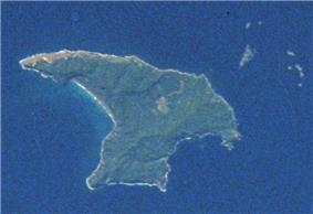 View taken from an orbiting spacecraft showing a roughly triangular-shaped island