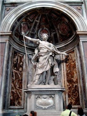 This statue shows a Roman soldier, with a cloak furling around him, gazing upward while he supports a long spear with his right hand and throws out his other hand in amazement.