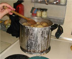 Salt potatoes being cooked in a pot