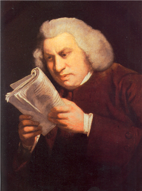 Man staring intently at a book held close to his face