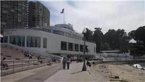 Photograph of the National Maritime Museum in the Aquatic Park Historic District. The waterfront museum is designed with the feel of an ocean liner.