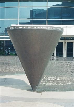 A sculpture of an upside down cone