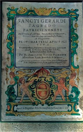 The first page of a book depicting a coat-of-arms that is held by two naked angels