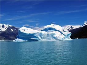 A glacier calving into the sea or a lake.