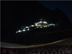 illuminated temple shrine seen in the dark hill