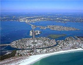 View of Sarasota beachfront on the Gulf of Mexico, in the foreground is Lido Key, St. Armand's Key, Otter Key, Coon Key, Bird Key, and the Florida Mainland, respectively with a view of Sarasota Bay